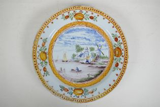 An C18th/C19th polychrome Delft charger decorated with a Dutch landscape, minor losses to glaze,