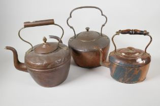 """Three C19th copper kettles, largest 12"""" high"""