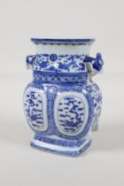 A Chinese black & white porcelain vase with two dragon head handles, decorated with dragons,
