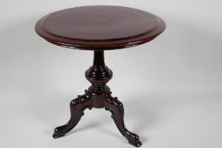 """A miniature rosewood circular occasional table on turned column and carved tripod base, 12½"""" x"""