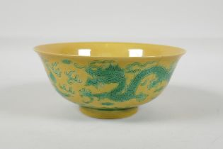 A Chinese yellow ground porcelain rice bowl with incised green enamel dragon decoration, 6 character