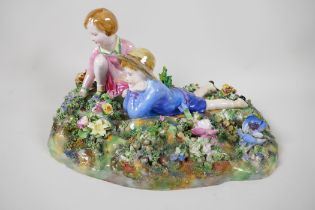 """A Crown Staffordshire figurine of two children in a garden, modelled by T. Bayley, A/F, 12"""" long"""