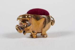 """A coppered metal miniature pig pin cushion, 1"""" long"""