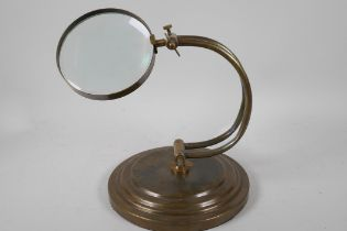 """An industrial style table top magnifying glass on adjustable brass frame, glass 4"""" diameter"""