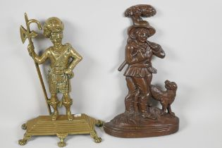 """A cast brass door stop in the form of a Scots Guard, 14"""" high, together with a coppered doorstop"""