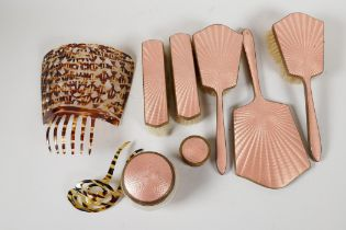 An Art Deco enamel backed seven piece dressing table set, together with two faux tortoiseshell