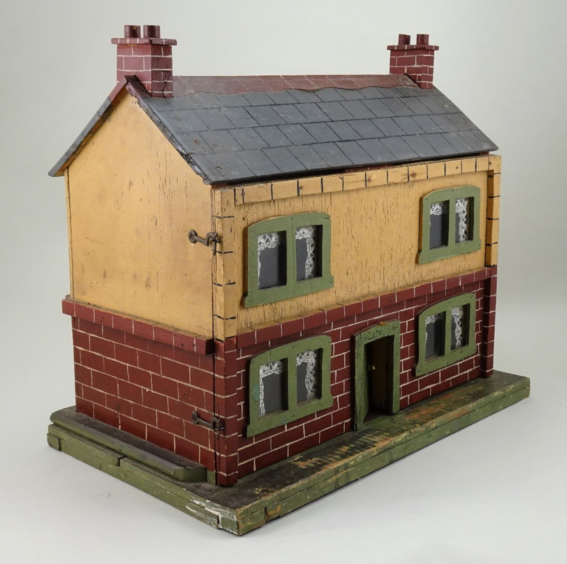 A small painted wooden dolls house, English circa 1920, - Image 4 of 4