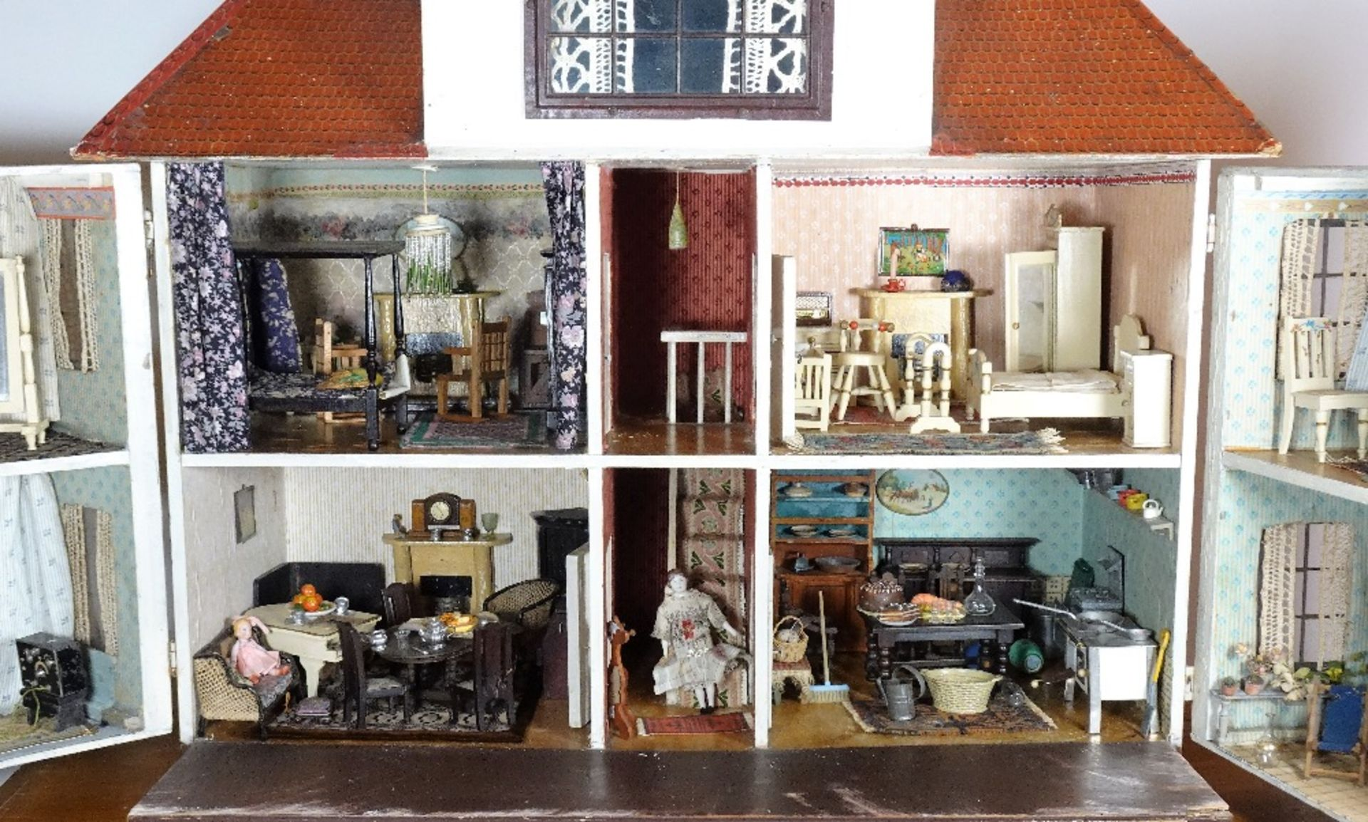 A large and impressive Lines Bros Triang painted wooden dolls house, English 1920s, - Image 2 of 6