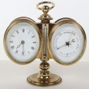 A late 19th century brass desk combination barometer and clock