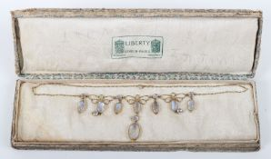 An Art Nouveau gold and moonstone necklace, in the style of Liberty & Co