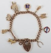 A 9ct gold charm bracelet 35g