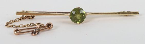 A 15ct gold and peridot set brooch