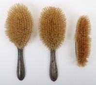 A silver dressing table brush set