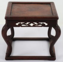 A 19th century small Chinese hardwood carved candle stand