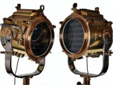 A superb and large pair of mid 20th century brass and metal naval signalling lamps on stands