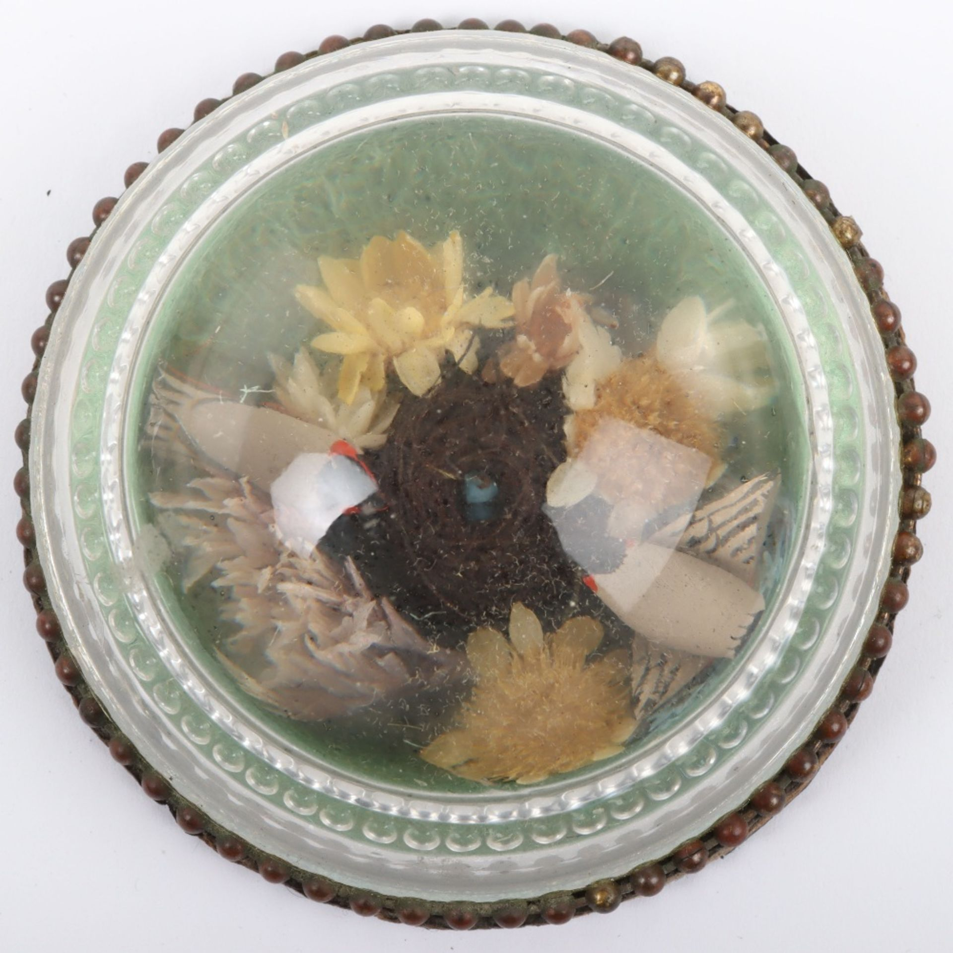 A charming rock crystal paperweight with nesting birds within