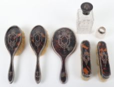 An early 20th century silver, tortoiseshell and pique work dressing table set, Charles Henry Dumenii