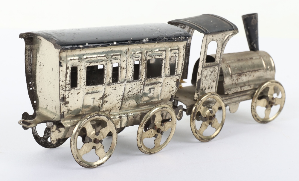 Early Meier pressed tinplate locomotive and carriage penny toy, German circa 1900 - Image 4 of 6