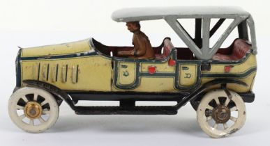 An early and good Distler tinplate friction driven four-seater tourer penny toy, German circa 1910