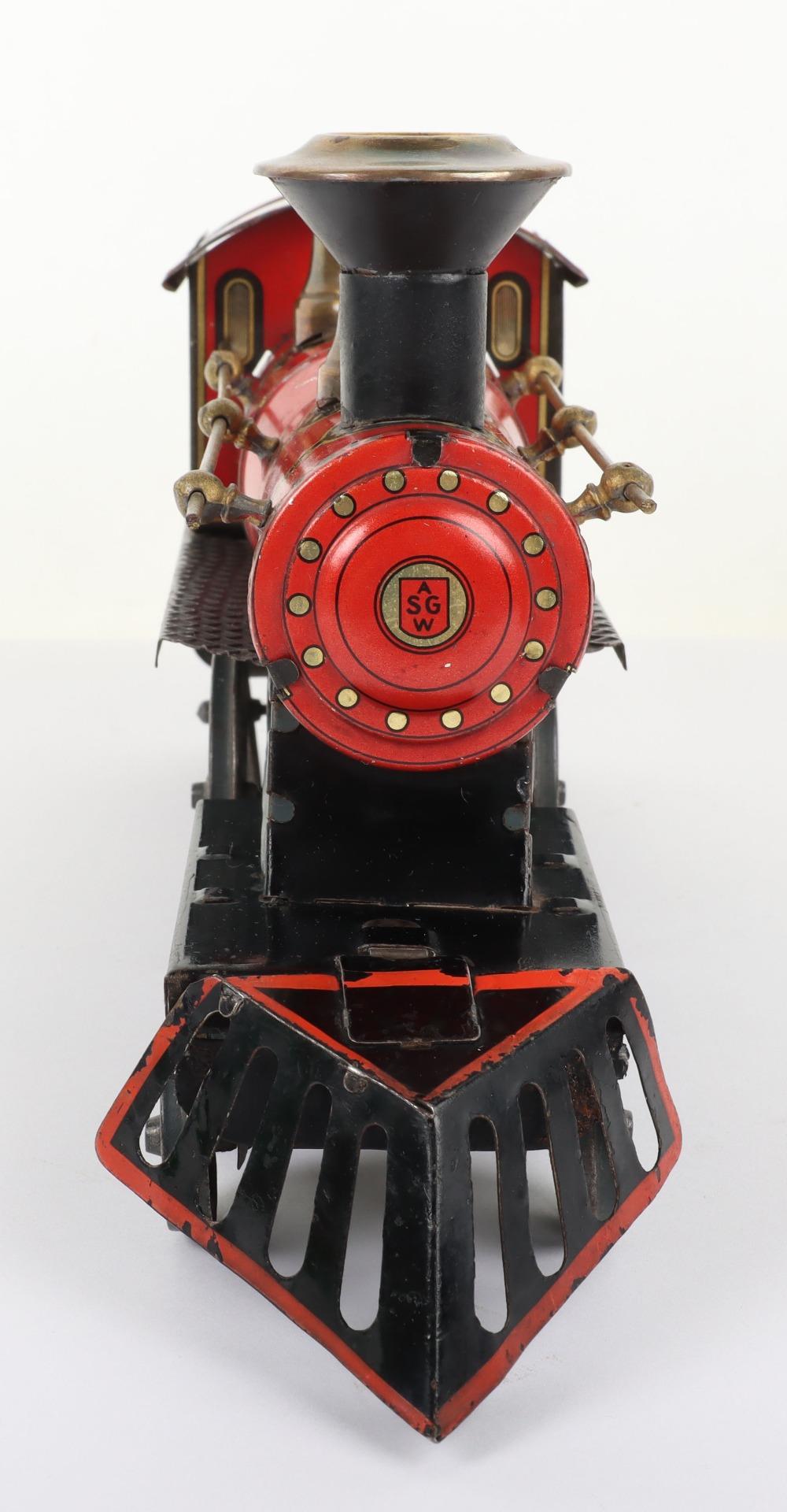 A Gunthermann tinplate 4-4-0 U.S outline floor train clockwork locomotive No.1273 and tender, German - Image 4 of 4