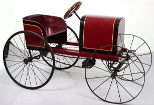 An Edwardian style wooden and metal child's chain driven pedal car
