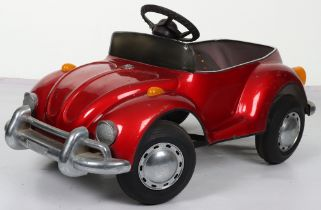 A pressed steel child's VW Beetle pedal car, probably English circa 1970