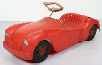 A Marx moulded plastic Triumph TR2 child's sit on push-along Sports car, circa 1970