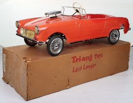 A Tri-ang Toys rare and early hard plastic MG Midget child's pedal Sports car, English released 1963