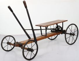 A rare Lines Bros Ltd wooden and metal hand propelled child's cart, English circa 1925