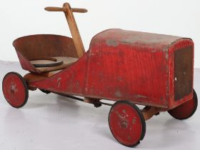 A pressed steel and wooden hand operated child's car, French 1920s