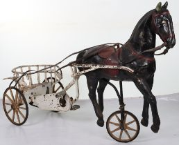 A very rare and early French pressed steel child's pedal horse and trap, circa 1900