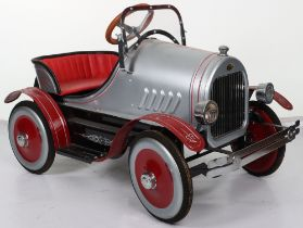 A classic USA reproduction pressed steel child's pedal car, American circa 2000
