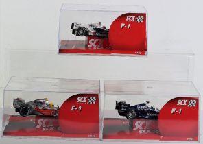 Three Boxed SCX F1 Model Slot Cars