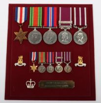 An Unusual WW2 Long Service Medal Group of Five to a Member of the Royal Army Pay Corps Who Retired