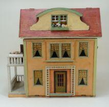 A Moritz Gottschalk model 6312 dolls house with garden, German 1927,
