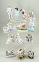 Collection of various German glazed and bisque dolls and figurines, circa 1910s/20s,