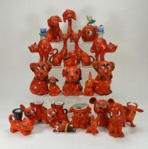 Collection of orange glazed china character animal novelty figures,