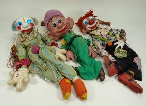 Four Pelham Puppet No.2 range puppets,