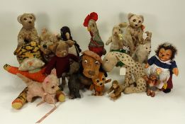 A collection of various soft toys,