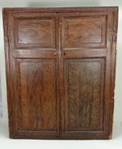 A rare and early 19th century English Dolls House cupboard and contents,