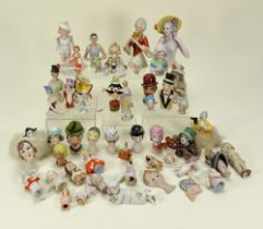 Collection of various glazed china half-dolls and pin-cushions,