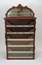 A Phillips' Cigarettes six drawer wall cabinet dispenser, early 20th century,