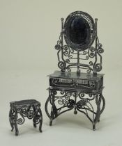 An unusual spun metal dressing table and stool,