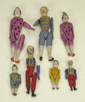 Seven painted carved wooden Erzebirge jointed toy figures, German 19th century,