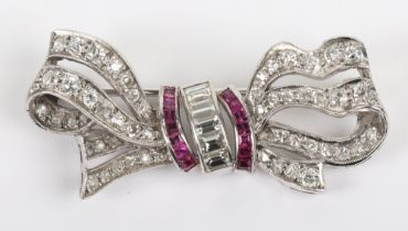 A white metal, diamond and ruby bow brooch