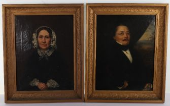 A pair of 19th century Continental oil on canvas portraits, German, of man and wife