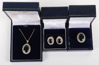 A set of three 9ct diamond and sapphire including ring, pendant necklace and earrings