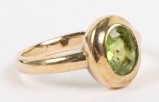 A 9ct gold and peridot single stone ring