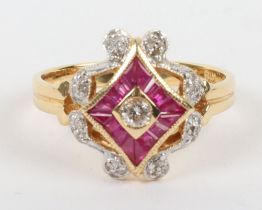 An 18ct diamond and ruby dress ring,