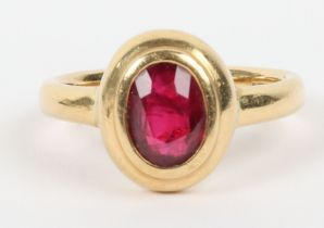 An 18ct gold and ruby set signet style ring